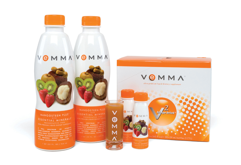 Vemma Product two 32oz bottles white with fruit on label, a shot glass, and a case of 30  2oz bottles